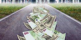 Geldscheine liegen auf einer Autobahn